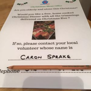 this image shows a poster offering free Christmas meals to the elderly who will be alone this year