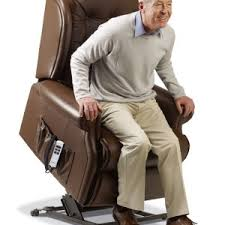 this image shows a man getting out of an rise and recline chair