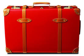this image shows an old style red suitcase