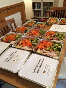 this picture shows a table full of home cooked roast Christmas dinners