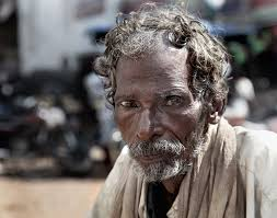 this image shows an indian beggar