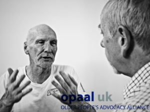 this is a black and white photo of a gentleman called Mike who is receiving help from the Olde People with Cancer advocacy group