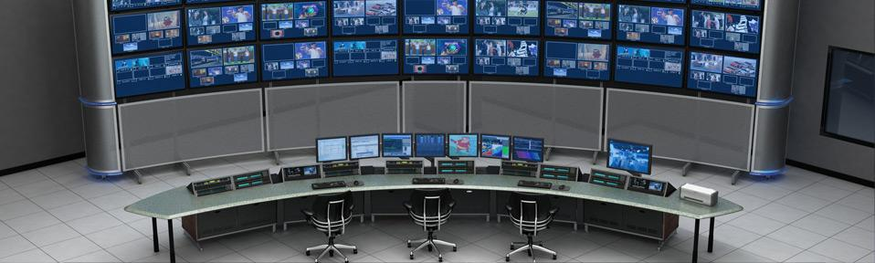 this image shows a control room full of monitors
