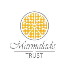 this image shows the logo for the marmalade trust which strangely enough is an orange cut in half!