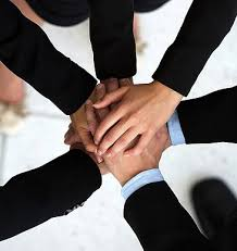 this picture shows a group of people hands joined together in an alliance, strength in numbers