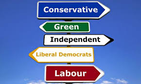 This image shows political party signposts