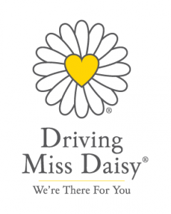 "this image shows a yellow heart with daisy petals and the wording ""Driving Miss Daisy"""