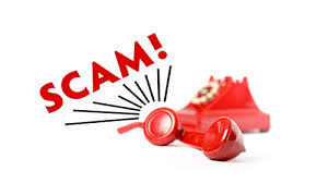 this image shows a red phone and the word scam