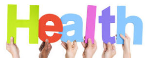 this image shows the word health spelt out in different colours and being held up by hands