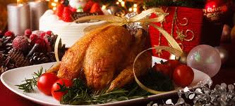 This image shows a whole turkey on a platter for Christmas