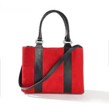 this image shows a red bag with black straps