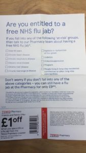 This image shows a photo of a leaflet advertising free flu jabs from Tesco