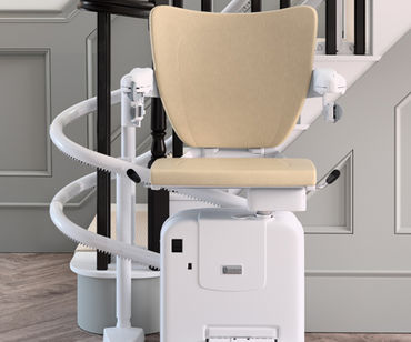this image shows a stair lift that works well with a curved staircase.