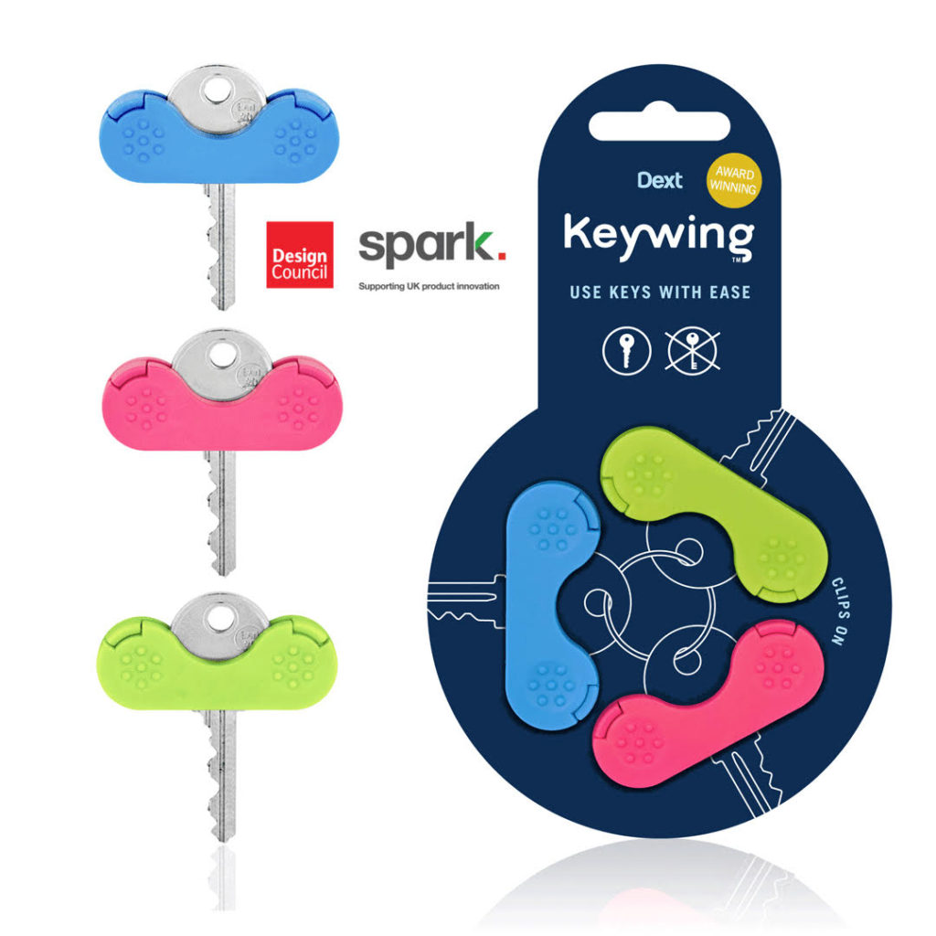 this image shows a set of 3 brightly coloured key holders designed for people with arthritic fingers